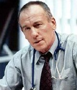 Christopher Timothy as Dr Brendan 'Mac' McGuire in 'Doctors'