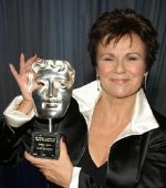 Julie Walters with one of her BAFTA Awards