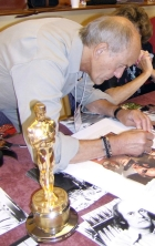 Norman Wanstall signing Ciaran Brown's Goldfinger lithograph