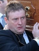 Jimmy White at the funeral of Alex Higgins
