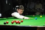 Jimmy White in action at the snooker table