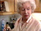 June Whitfield as Mrs White the housekeeper in 'Cluedo'