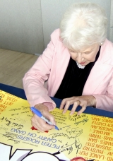 June Whitfield signing 'Carry On' poster