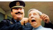 Norman Wisdom is 'arrested' by an Albanian policeman