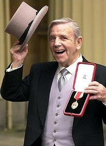 Sir Norman Wisdom after receiving his knighthood in 2000