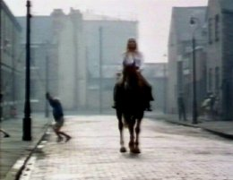 The Ragman's Daughter - Victoria Tennant rides her horse Marion along Brand Street