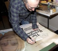 Simon Rouse signing 'The Ragman's Daughter' poster