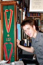 Ciaran Brown by the case that holds Patrick's honours - his knighthood (above) and his CBE (below)