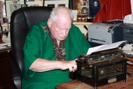 Sir Patrick Moore typing Ciaran Brown's letter
